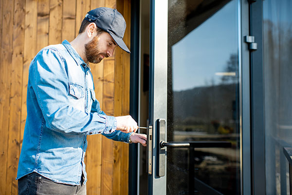 man repairing door lock